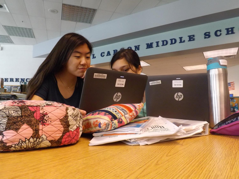 Eighth-graders Arielle Kim and Sreya Devarakonda hard at work on their Capstone project.