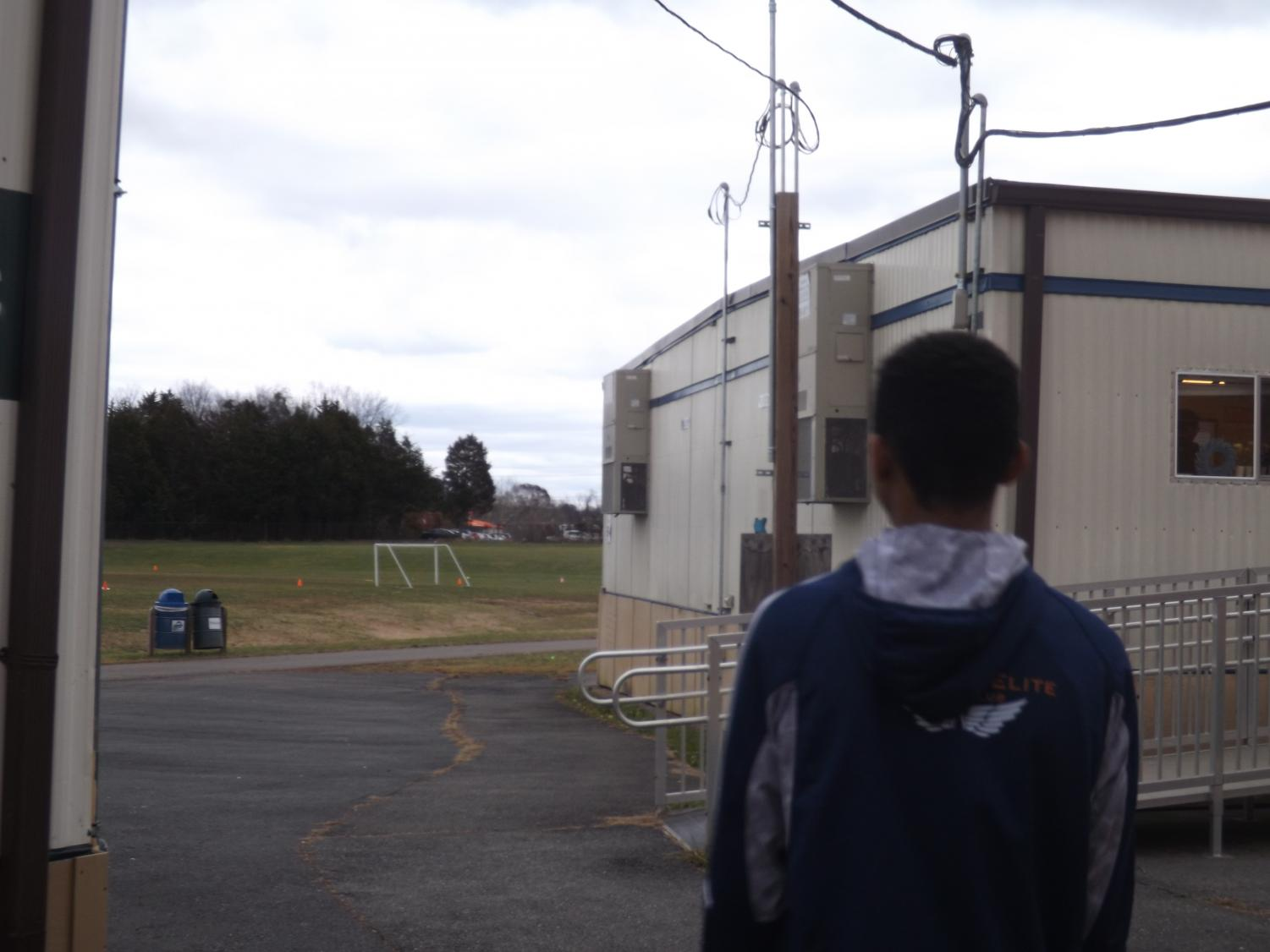 Jayson Bell, 13, of the X-Treme Team, walks to his class in the trailers.