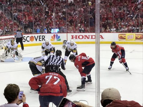 TJ Oshie (foreground), Nicklas Backstrom and Evgeny Kuznetsov prepare for puck drop.