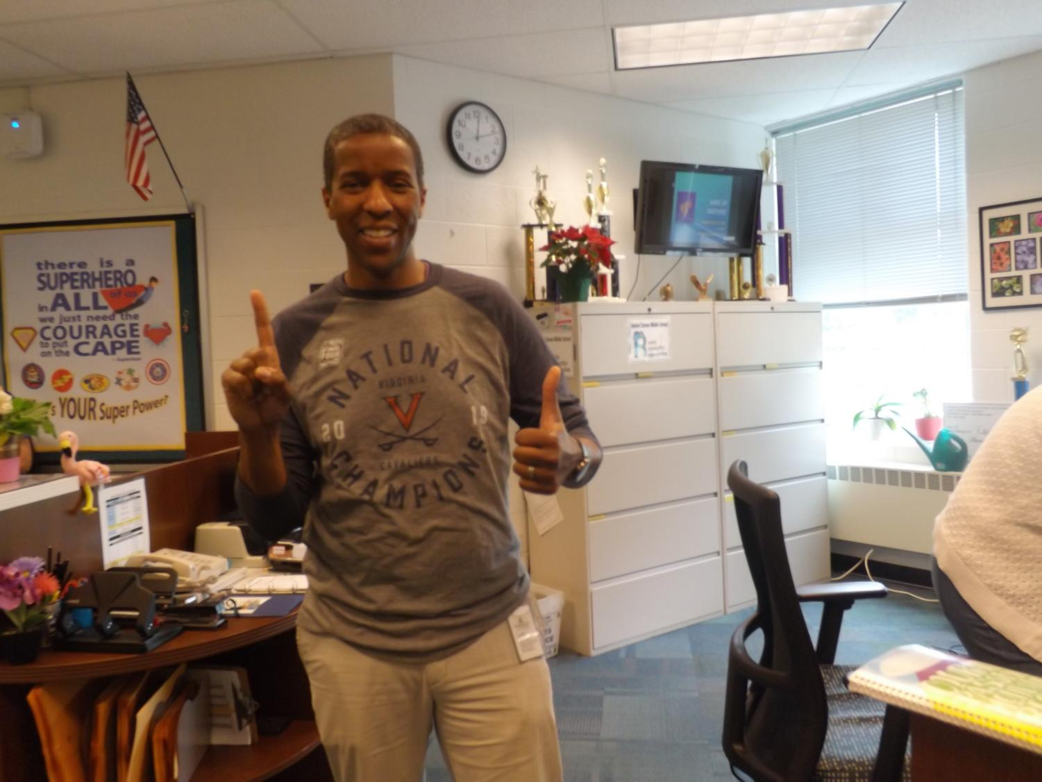 Mr. Stokes in his Virginia National Champions  T-shirt as he celebrates the win over Texas Tech