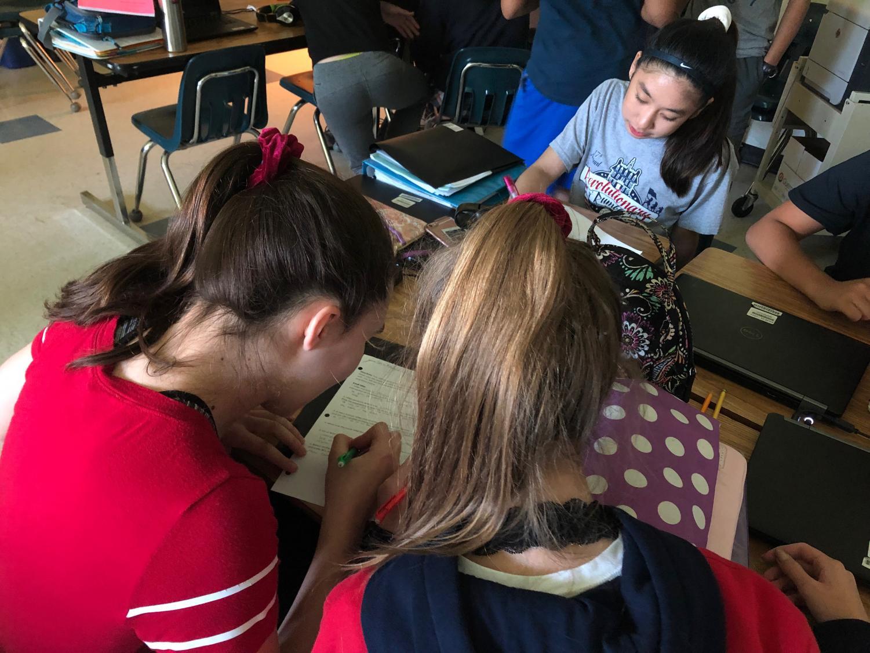 On May 21, 2019 Seliz Aktuglu, Nicole Nguyen, and Elizabeth Zhukova are studying hard for the math SOL.