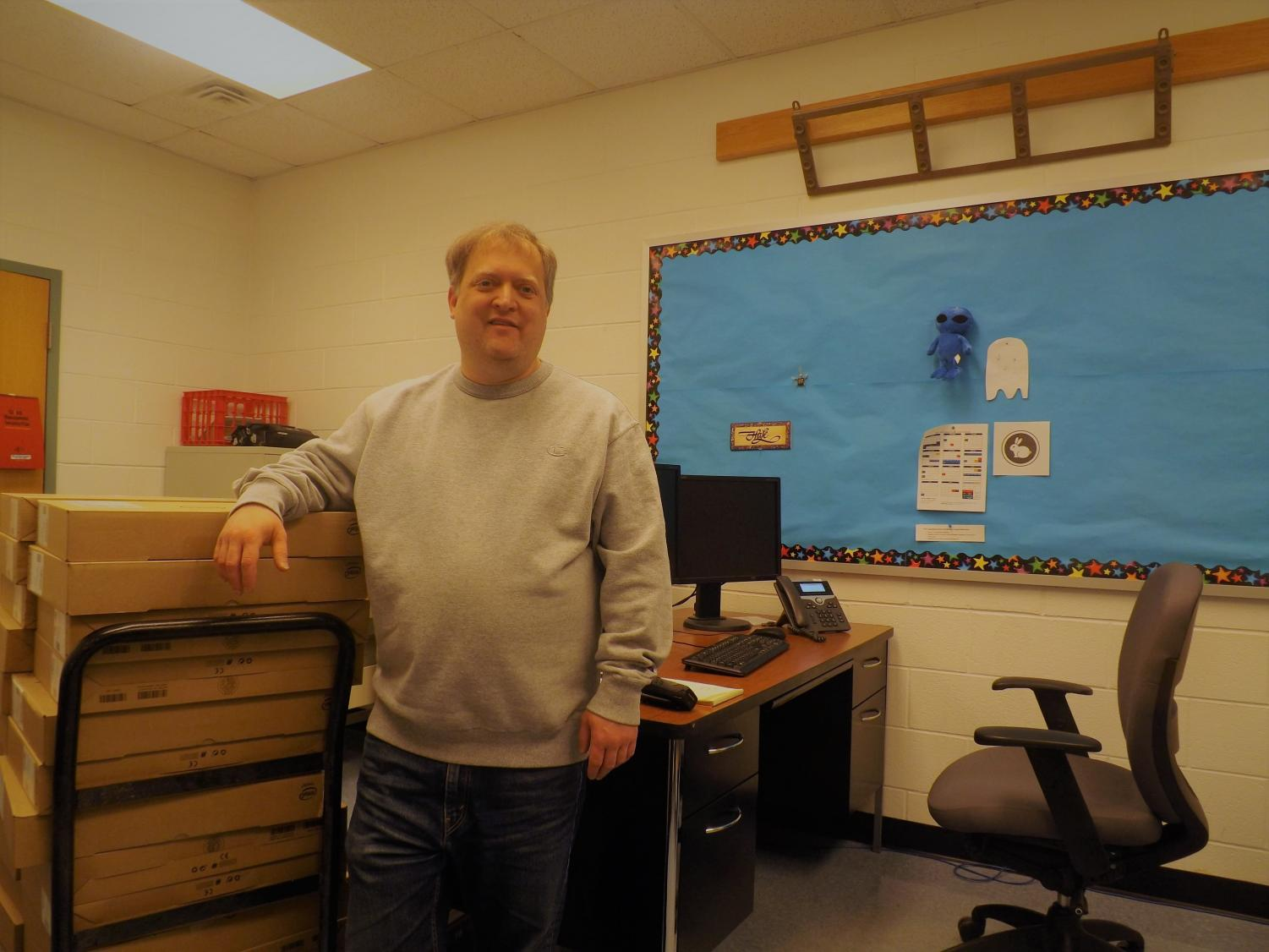 Mr.Hale with a new stack of computers for tech ed.