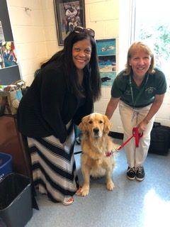 Ms. Terry, assistant principal of RCMS, and Ms. Doyle, Tucker's owner, pose with Tucker, a therapy dog, on May 30. Ms. Terry, assistant principal of RCMS, and Ms. Doyle, Tucker's owner, pose with Tucker, a therapy dog, on May 30.