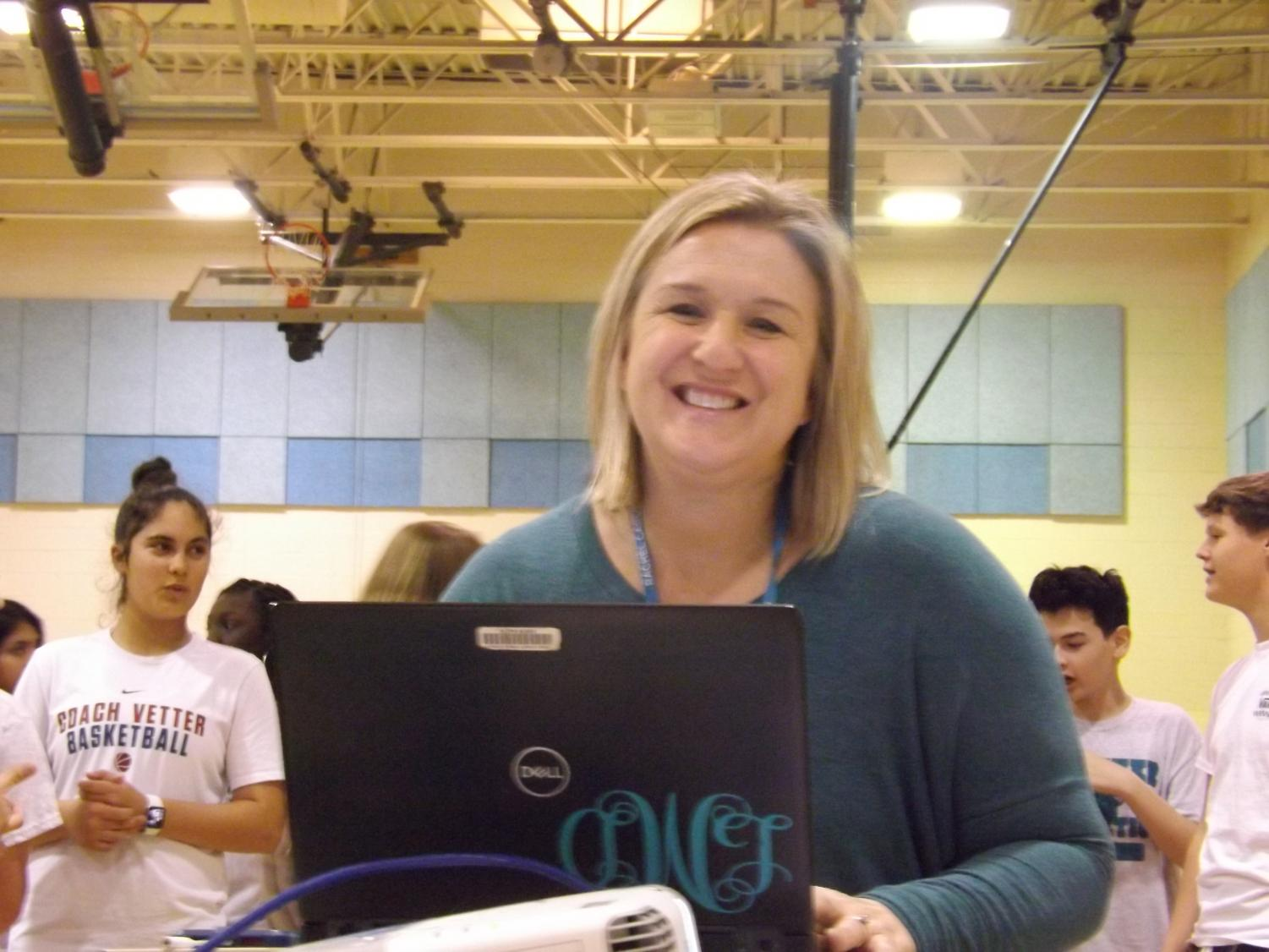 Ms. Molnar teaches P.E. class to RCMS students. 'I just love teaching especially during the 5K season,' she said.