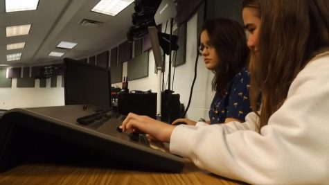 "Alara Lay and Maria Craig experiment with the lights and sound equipment in the Lecture Hall for ""Dark Road.""  Photo by Rehaan D'Souza-Bohannon."