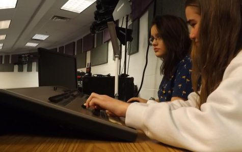 """Alara Lay and Maria Craig experiment with the lights and sound equipment in the Lecture Hall for """"Dark Road.""""  Photo by Rehaan D'Souza-Bohannon."""