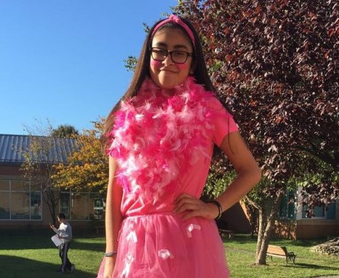 A student dresses in pink for a past Pink Panther Day at school.
