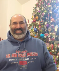 As someone who loves space, Mr. Moosa Shah, a seventh grade Biology teacher shows off his NASA Air and Space Museum sweatshirt.