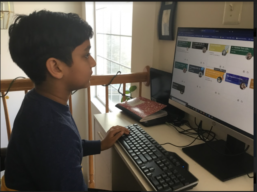 Seventh-grader Anay Bansal studies online in quarantine in December. When heard about the vaccine, he said,