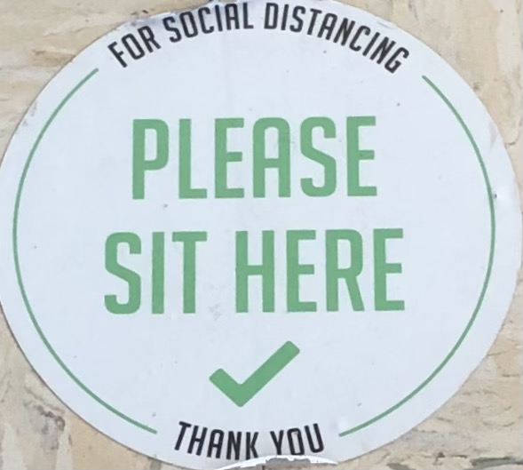 Stickers in the lunch room at RCMS remind students to sit down.