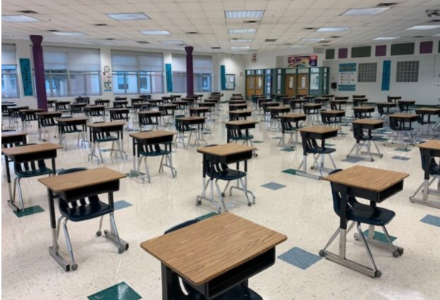 Desks+are+set+up+for+social+distancing+in+the+cafeteria+in+this+photo+shown+during+the+RCMS+Parent+Town+Hall+Presentation+on+Feb.+22.