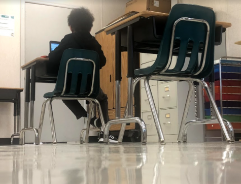 Seventh-grader Anthony Muse works on his computer at a socially distanced desk