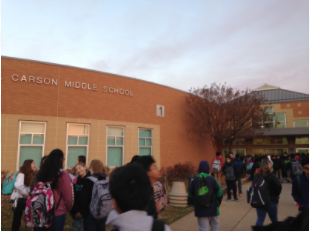 RCMS students walking in building for in person school