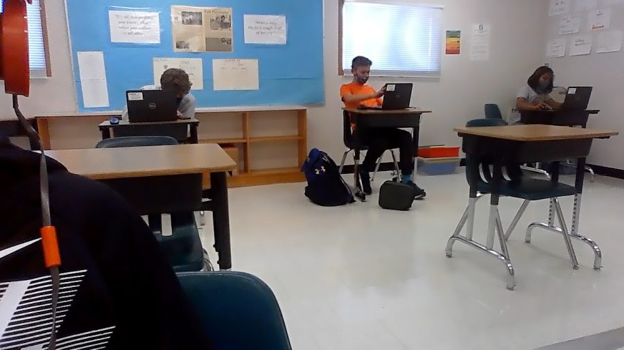 Students in class working